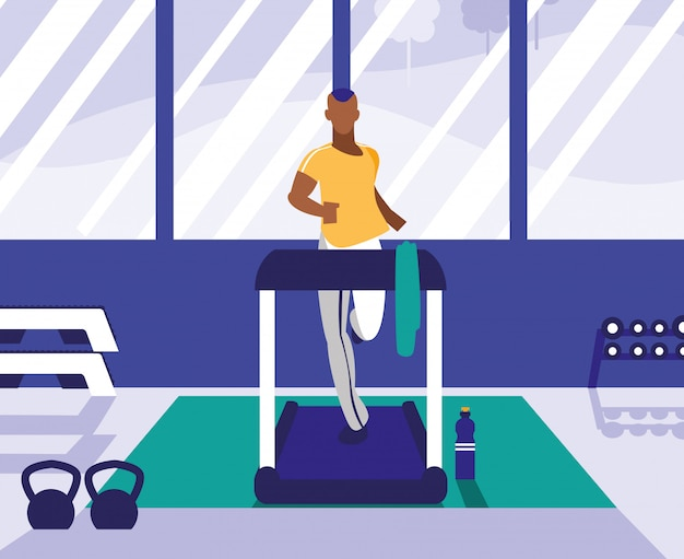 Homem afro com máquina de corredor no ginásio