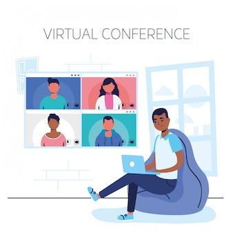 Homem afro usando laptop na comunicação da conferência virtual