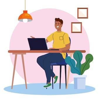 Homem afro usando laptop na mesa, trabalhando ilustração online