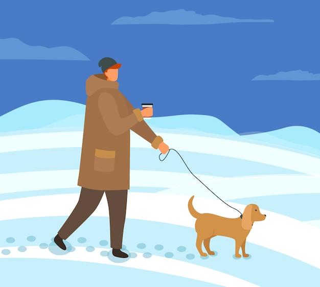 Homem andando com cachorro na noite de inverno lá fora