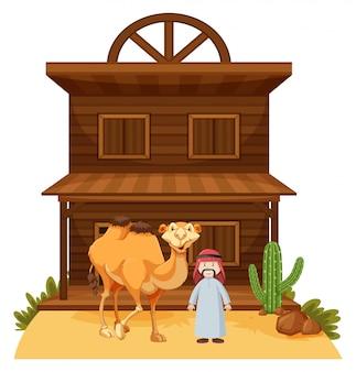 Homem árabe e camelo no edifício de estilo ocidental