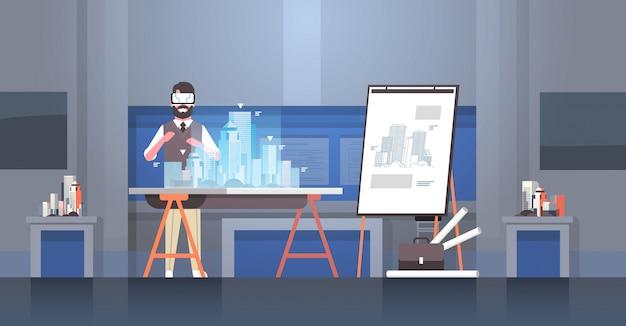 Homem arquiteto engenheiro usando óculos digitais realidade virtual 3d edifício cidade modelo vr modelagem