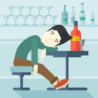 Homem bêbado adormece no bar.