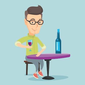 Homem bebendo vinho no restaurante.