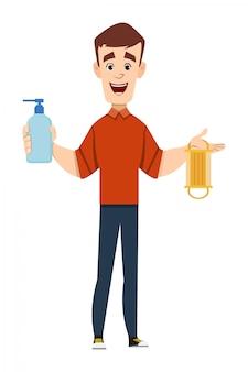 Homem bonito, segurando e mostrando a garrafa de gel desinfetante e máscara facial