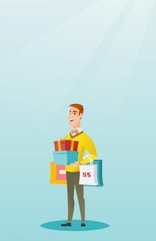 Homem caucasiano, segurando sacolas de compras e caixas de presente