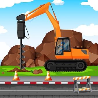 Homem cavando buraco com broca no canteiro de obras