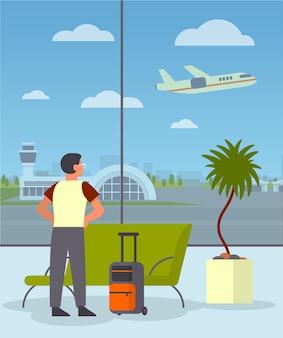Homem com a bagagem na sala de espera do aeroporto. ideia de viagem
