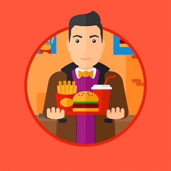 Homem com a bandeja cheia do fast food.