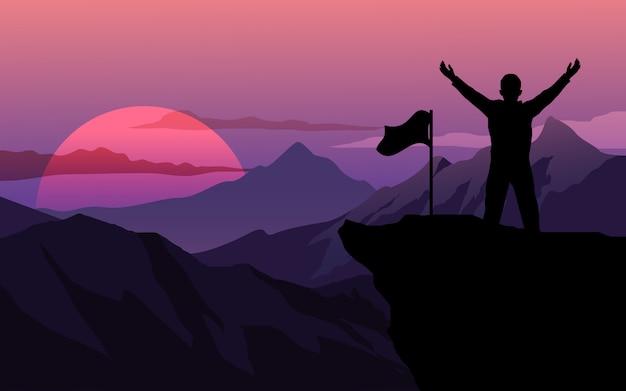 Homem com bandeira em pé no topo da montanha
