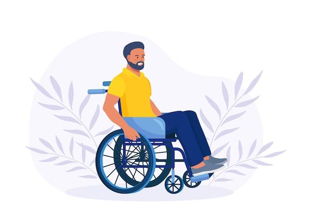 Homem com deficiência sentado na cadeira de rodas e segurar a roda. jovem com deficiência. conceito de deficiência