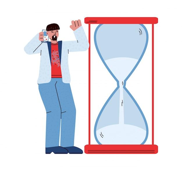Homem com estresse de prazo, olhando para o relógio de ampulheta com pouco tempo restante
