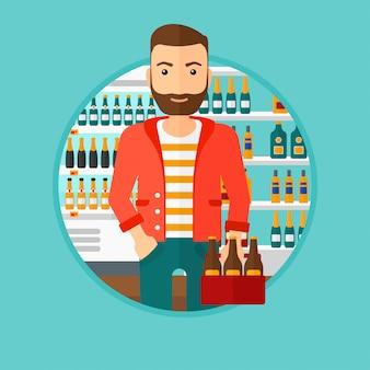 Homem com maço de cerveja no supermercado.