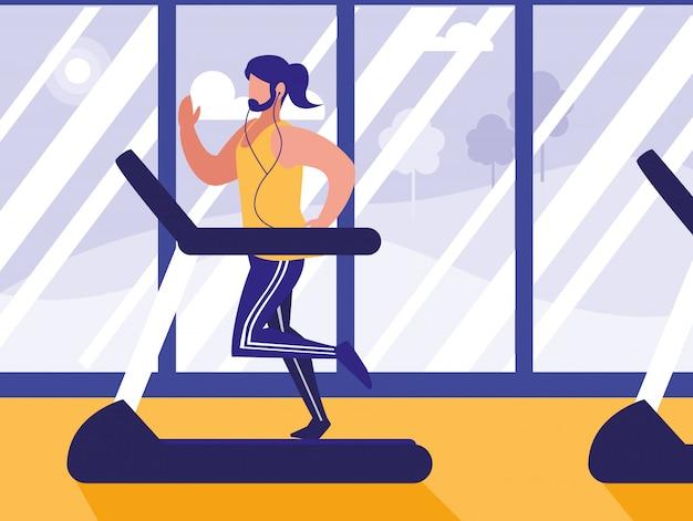 Homem com máquina de corredor no ginásio