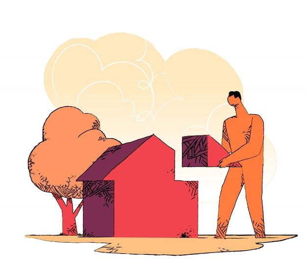 Homem completar a casa com o pedaço do telhado