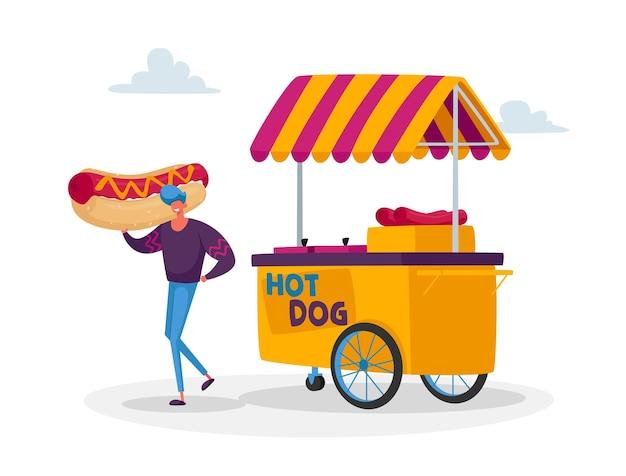 Homem comprando comida de rua, comida de lixo para viagem no wheeled cafe ou food truck