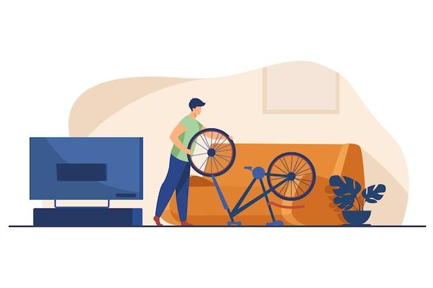 Homem consertando bicicleta em casa.