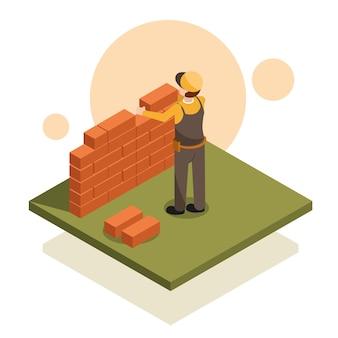 Homem construindo parede de tijolos