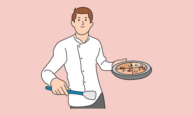Homem cozinhando e segurando uma bandeja com pizza