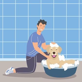 Homem dá banho em cachorrinho