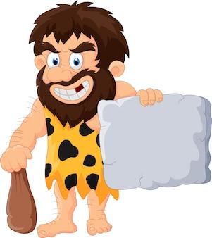 Homem das cavernas com tablet de pedra