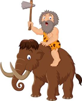 Homem das cavernas montando um mamute