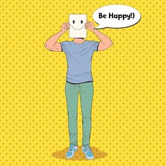 Homem de arte pop com emoticon sorridente na folha de papel