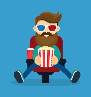 Homem de barba sorridente feliz jovem hipster no cinema. em óculos 3d e pipoca assistindo filme.