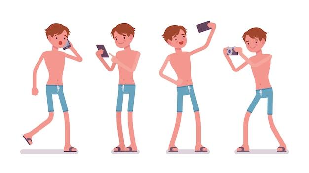 Homem de calção de banho azul com gadgets