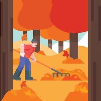 Homem de jardineiro, ajuntando as folhas de outono