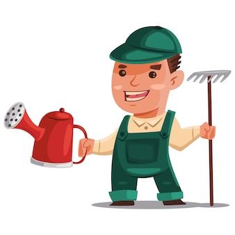 Homem de jardineiro em um terno de trabalho com um regador e um ancinho para o processamento do solo.