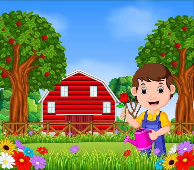 Homem de jardineiros com segurando uma flor e regador