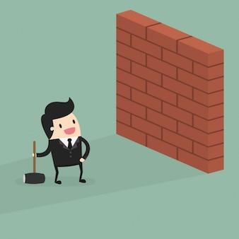 Homem de negócio com uma parede