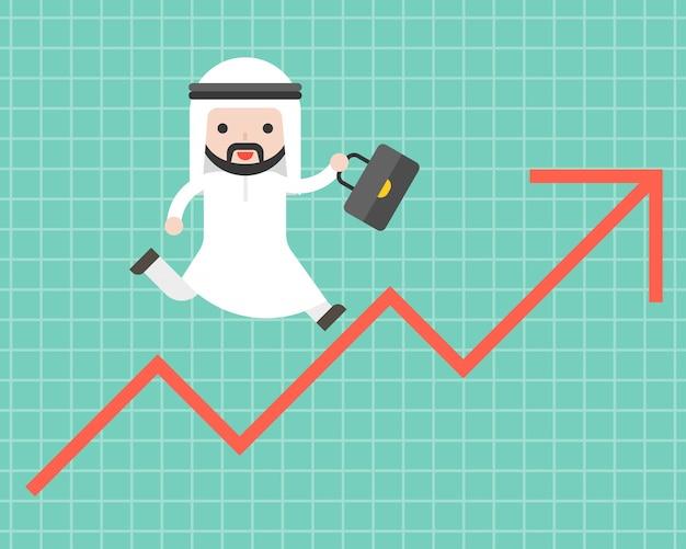 Homem de negócios árabes bonito correndo na seta para cima