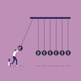 Homem de negócios com a palavra de sucesso no equilíbrio de bolas de newtons embala o sucesso e o conceito de negócio