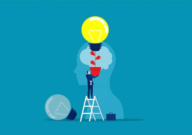 Homem de negócios de terno segurando uma lâmpada na cabeça superior humana chang idéia conceito vector