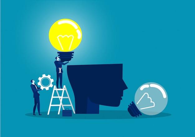 Homem de negócios de terno segurando uma lâmpada no conceito de idéia de cabeça humana humana chang