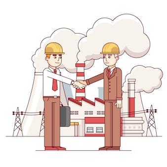 Homem de negócios e engenheiro apertando as mãos