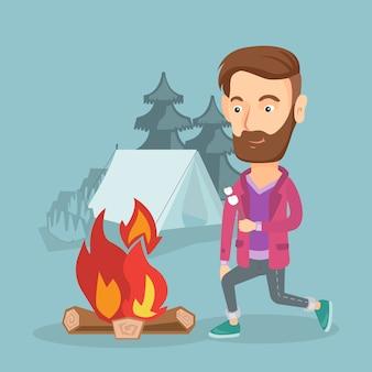 Homem de negócios que roasting o marshmallow sobre a fogueira.
