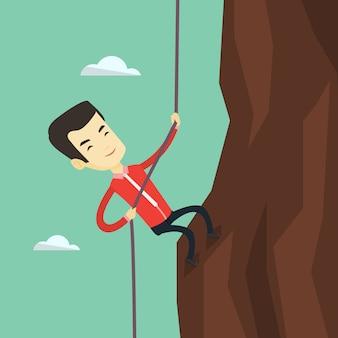 Homem de negócios subindo a montanha.