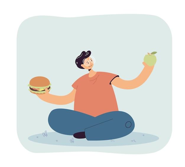 Homem de óculos escolhendo entre frutas e junk food
