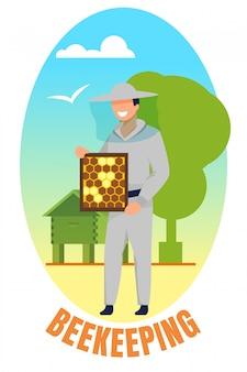 Homem de uniforme segurando o quadro com favos de mel de abelha.