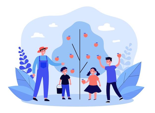 Homem e crianças colhendo maçãs no jardim