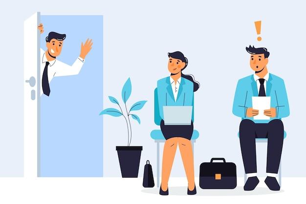 Homem e mulher à espera de uma entrevista de emprego