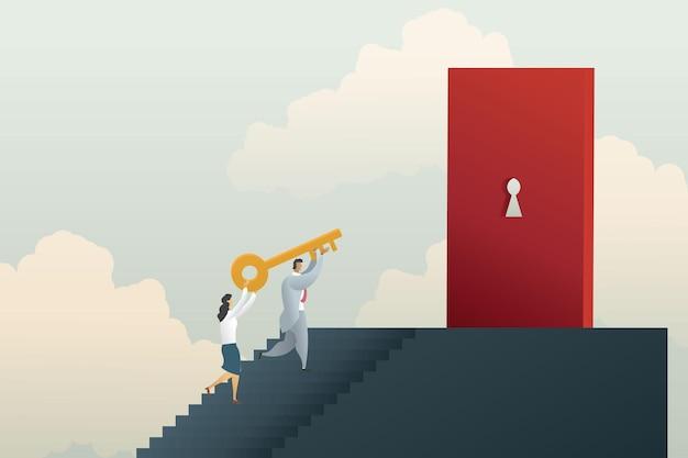 Homem e mulher de negócios sobem escadas segurando a chave dourada para destrancar a porta