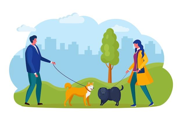 Homem e mulher estão andando com o cachorro. cachorrinho na coleira
