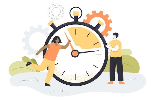 Homem e mulher minúsculos movendo as mãos de relógios gigantes, cronômetro