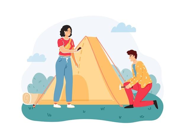 Homem e mulher montam ou armaram uma barraca na natureza. lazer extremo ao ar livre.
