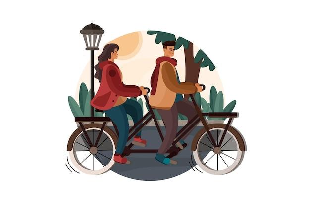 Homem e mulher pedalando em uma bicicleta dupla no parque