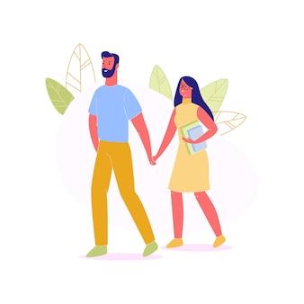 Homem e mulher que guardam as mãos que andam junto.